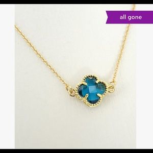 Blue crystal and gold tone clover necklace
